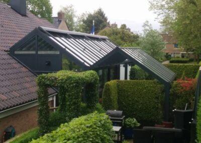 Alufox serre op maat geïntegreerd in woning met veranda